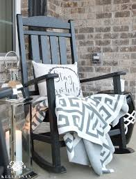 black rocking chair on front porch with lantern fall inspiration throughout outdoor chairs plan 18