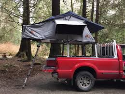 Nice example of a pickup bed mounted roof top tent opening over the ...