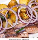 baked fish with potatoes and onion rings