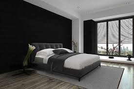 in this particular bedroom the dark walls are complimented with a by a light grey thin area rug with