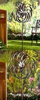 metal spinning yard art farm and garden double spiral wind spinner garden stake solar power light metal spinning yard art