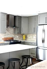 black cabinets with white countertops kitchen painted gray with white quartz and driftwood marble tile antique