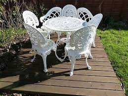 white cast iron garden table and chairs
