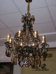 wonderful antique bronze 4 light round crystal chandelier wrought iron chandelier large round with modified fleurdelis
