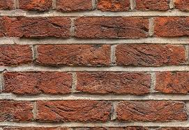 old red brick wallpaper close up view