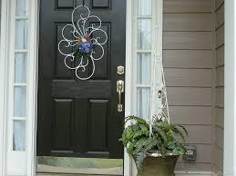 exterior faboulus black wooden front door decoration with ornate white ornament plus brushed door handle