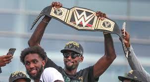 WWE, Triple H gives Milwaukee Bucks title belt for NBA championship