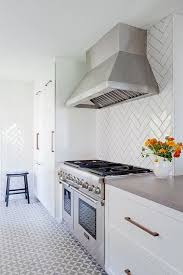 How To Grout Tile Backsplash Magnificent White And Gray Galley Style Kitchen Features White Shaker Cabinets