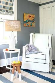 black and white nursery rocker with blue striped rug runner