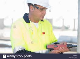 using electric drill. builder using electric drill on construction site
