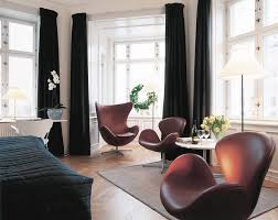 elegant scandinavian living room design with brown leather arne jacobsen swan chairs and egg chair on bay window with black curtain arne jacobsen egg chair leather black