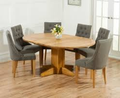 mark harris monte carlo solid oak round extending dining set with 4 pailin grey chairs