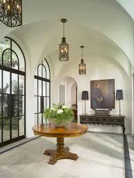 mediterranean lighting. style of the doors and lovely lighting creates a cool mediterranean vibe design summerour