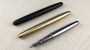 Sleek, minimal, and elegant fountain pen in solid titanium, brass, and black