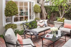patio furniture design ideas. Black Iron Patio Furniture With Neutral Cushions And Fish Scale Throw Pillows On Brick Back Design Ideas O
