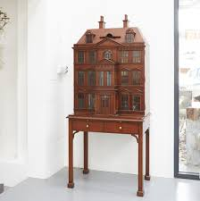 a maitland smith tail cabinet in the form of a georgian dolls house