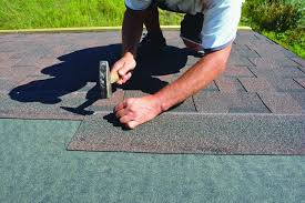 Roofer Installing Asphalt Shingles On House Roofing