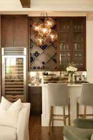 Living room bars furniture Dining Chic Living Room Bar Features Dark Stained Shaker Cabinets Paired With White Marble Countertops Pinterest Chic Living Room Bar Features Dark Stained Shaker Cabinets Paired