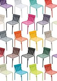 matali cret s brightly colored stripe chair for fermob contains a playful curved form