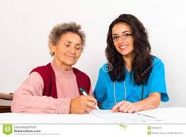 Nurse Helping Elderly Register For Nursing Home Stock Photo Image