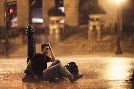 sad guy in rain