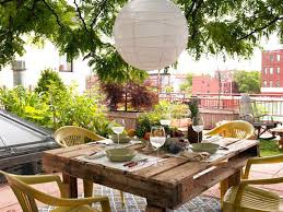 diy pallet outdoor dinning table. Lovely Outdoor Dining Sets With Wooden Pallet Table And Yellow  Plastic Chairs Also Ball White Hanging Paper Lantern Diy Pallet Outdoor Dinning Table