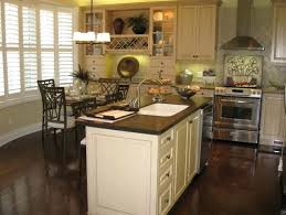 white kitchen cabinets with dark floors antique white kitchen cabinets with dark wood floors off white