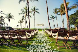 wedding arch, 6000 orchids spinkled down aisle, white orchid aisle Wedding Ideas In Hawaii wedding arch, 6000 orchids spinkled down aisle, white orchid aisle garland, flowers by wedding anniversary ideas in hawaii