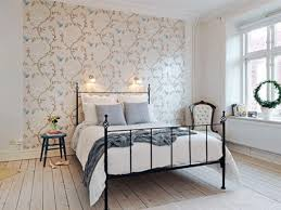 Simple minimalistic pastel bedroom with floral wallpaper for romantic look.