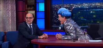 Stanley Tucci confronts Stephen Colbert on his Hunger Games impersonation