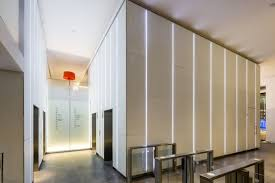 paul nulty lighting design city tower city of london sophisticated commercial reception space clean vertical lines light