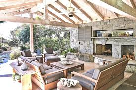 outdoor fireplace under covered patio outdoor furniture