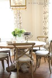 beautiful dining space with restoration hardware pedestal salvaged wood round table restoration hardware madeline side chair weathered oak drifted finish