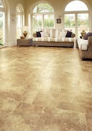 brown color luxury vinyl wood flooring for large living room with rattan ottoman table and rattan sofa with fabric cushions ideas