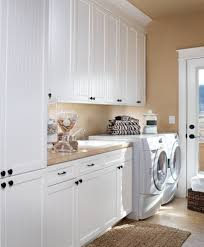 wall mount clothes drying rack Laundry Room Traditional with beadboard  cabinets built in cabinets. Image by: DeWils Custom Cabinetry