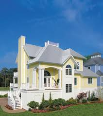 Photo Tour   Sater Design Collection  Inc  The Aruba Bay House    An raised foundation adds to the island inspired charm of Aruba Bay  Topped   a metal roof  this charming villa is perfect as either a vacation home or