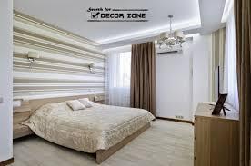 neutral master bedroom design and light brown wallpaper