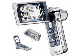 lg flip phone 2003. in 2005 the nokia n90 landed to take camera phone new heights. not only did it boast a 2mp camera, also had carl zeiss optics, autofocus, lg flip 2003 r