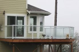 white large glass panel railing on balcony of