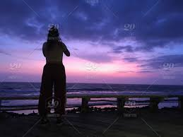 The Silhouette Of A Woman Making A Photo Of An Amazing