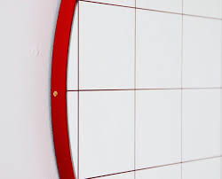 large red orbis round mirror with grid