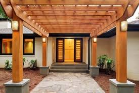 exceptional wooden porch cover with stone concrete floors as natural entrance ideas for home added wall lights hang on column inspiring pictures