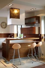 Small Modern Kitchen Design In Natural Wood Tones And White Walls. Kitchen  Includes Eat
