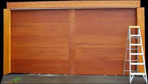more people switching from overhead garage doors to carriage doors non warping patented wooden pivot door sliding door and eco friendly metal cores