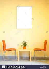 decorated office. Blank Office Advertising Space. Ad Space Mockup With A Wooden Table And Two Chairs, Decorated Artificial Flower.