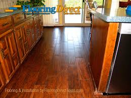 wood look tile through kitchen to sliding glass door pool entrance