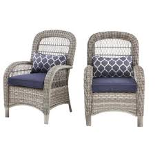 hampton bay beacon park gray wicker outdoor captain dining chair with midnight cushions 2 pack