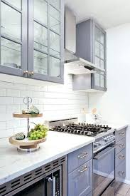 white kitchen cabinets with glass tile backsplash tile gray kitchen cabinets with white beveled subway tile
