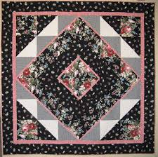 Welcome to: Maggie's Medallion quilt in Mc Call's Quick Quilts ... & It's a pretty good size, measuring 85 1/2