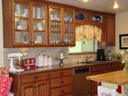 kitchen storage cabinet made of oak wood with glass doors